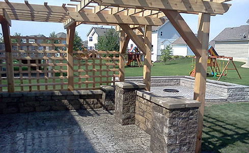 Stamped Patio featuring Seating Wall, Pillars, Pergola & Fire Pit