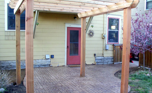 Stamped & Stained Concrete Patio with Pergola