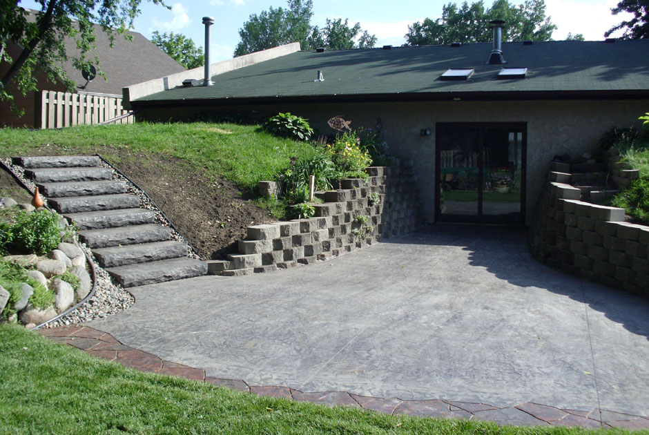 Stamped Concrete Patio with Steps & Brick Wall
