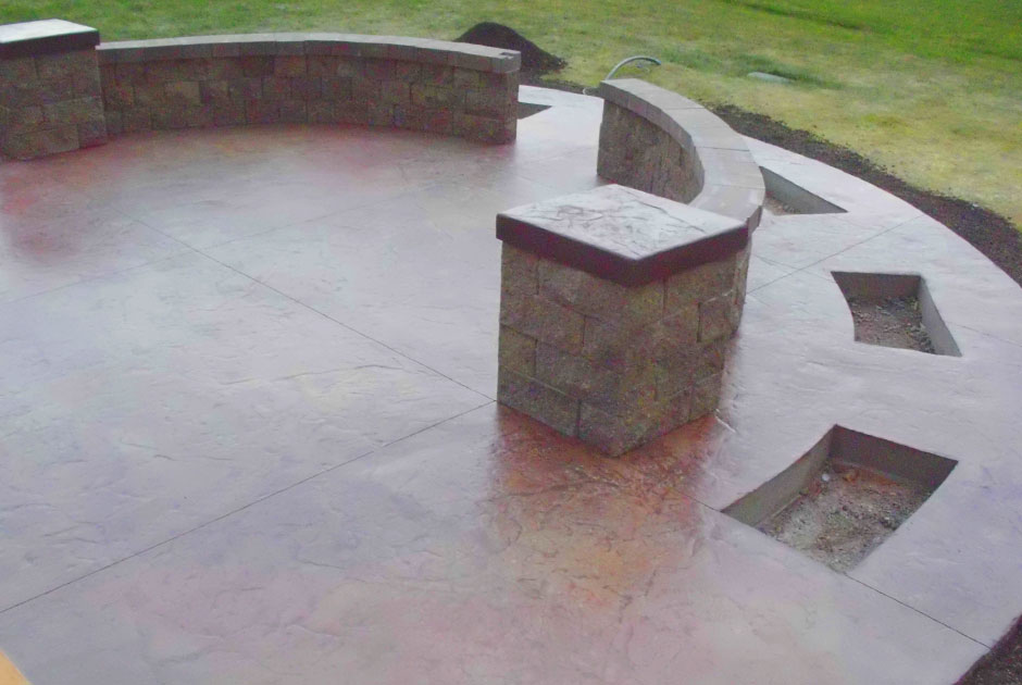 Stamped & Stained Concrete Patio with Brick Sitting Wall