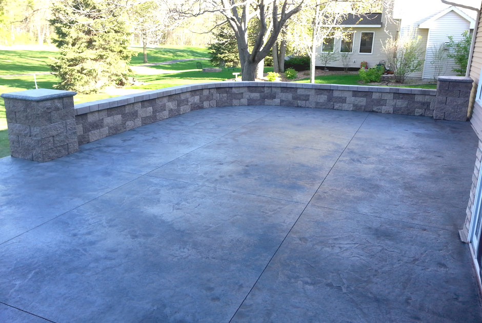 Stamped Concrete Patio with Steps, Brick Wall, and Pillars