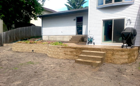 Brick Retaining Wall with Stamped Concrete Patio & Steps