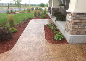 Stylish stamped concrete sidewalk and steps